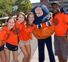 Students posing with Otto the Orange
